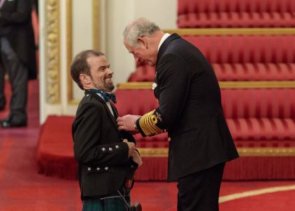 Grant Douglas recieving the MBE from Prince Charles at Buckingham Palace